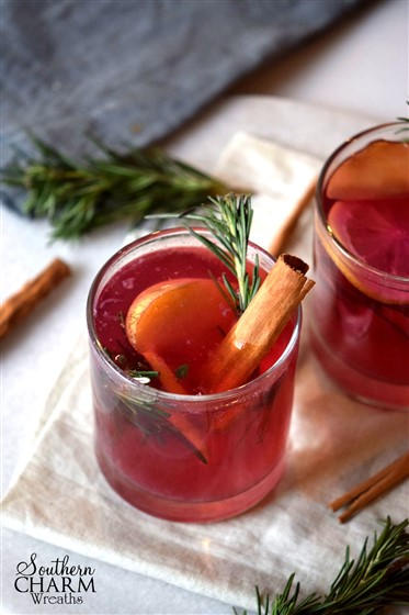 Combine apples, cranberries, clove and cinnamon for a fall mocktail by www.southerncharmwreaths.com/blog