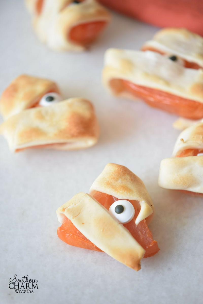 Wrap tomatoes with puff pastry for a Monster Bites recipe this Halloween. www.southerncharmwreaths.com/blog