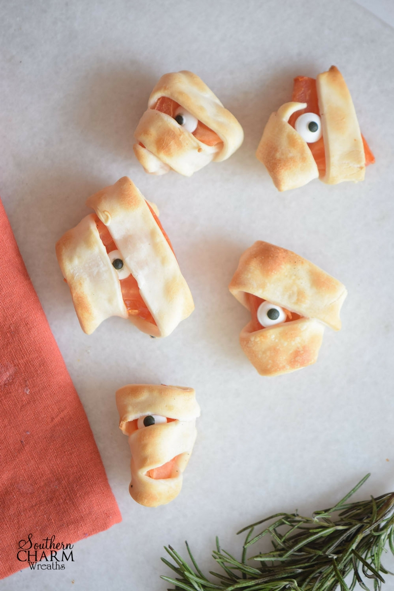 Simple Monster Bites recipe using puff pastry and tomatoes for a spooktacular treat this Halloween. www.southerncharmwreaths.com/blog