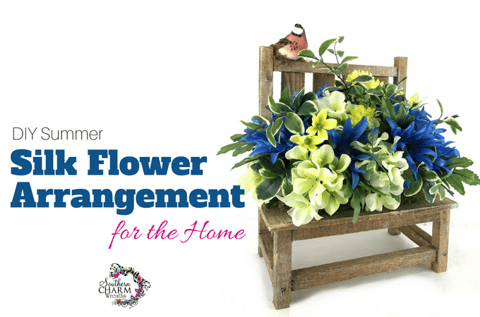 In this video, create a DIY Summer Silk Flower Arrangement for your home using a wooden bench.