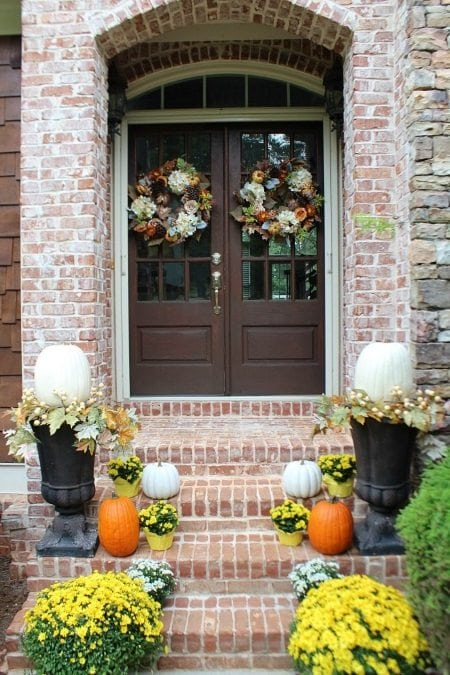 I love the double wreaths on this porch. For more inspiration, read our 15 Gorgeous Fall Porches Roundup.