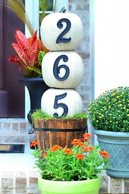 15 Gorgeous Fall Porches includes a pumpkin stack to display your house numbers.