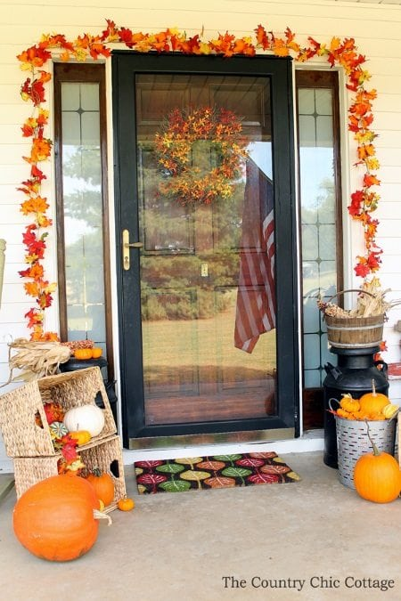 15 Gorgeous Fall Porch Ideas using leaf garlands.