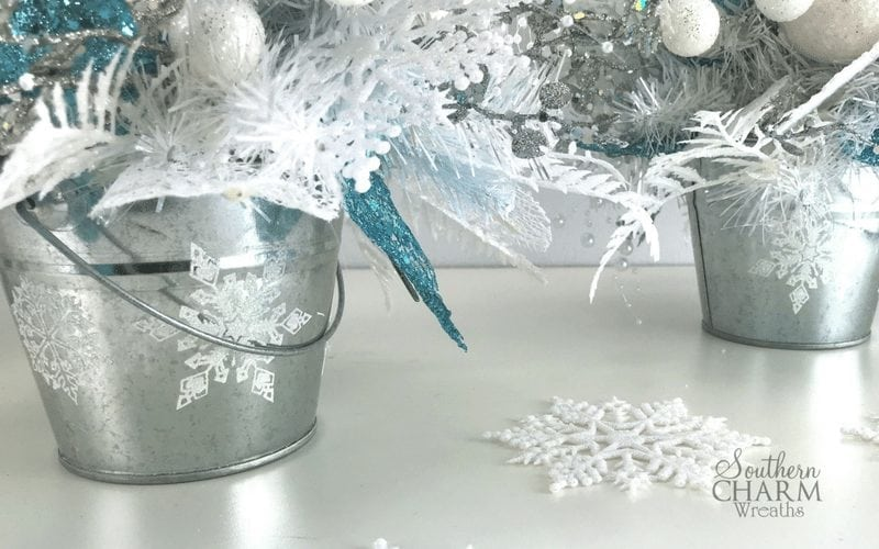 Use chalk couture snowflake transfers and past on tin cans for a frosty effect.