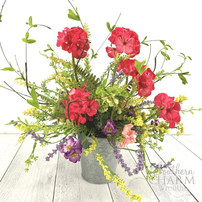 Rustic Spring Centerpiece with galvanized bucket and silk flowers