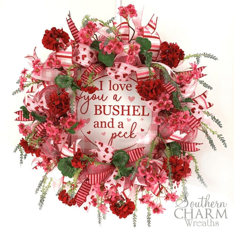How to make a deco mesh Valentine's Day Wreath using 10 inch mesh, ribbon and silk flowers by Southern Charm Wreath.