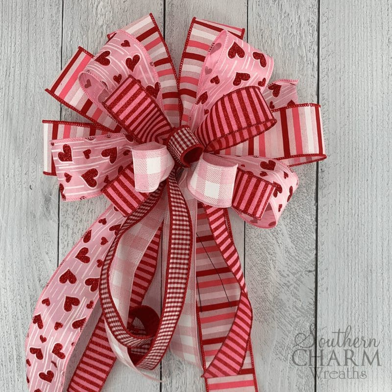 Valentines day bow with multiple ribbons