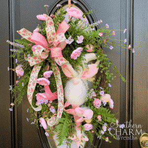 pink and green silk flower wreath with gnome and ribbon bow for Easter decor