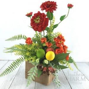Orange and Red Summer Silk Flower Arrangement using Fruit and Zinnias