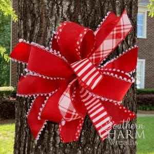 red ribbon bow showing unity and support for healthcare workers