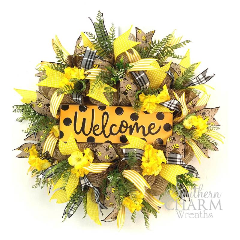 black, yellow, and burlap wreath with welcome sign