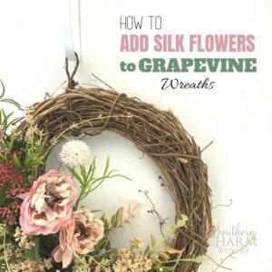 """How to add silk flowers to grapevine wreaths"" - brown wreath with pink silk flowers"