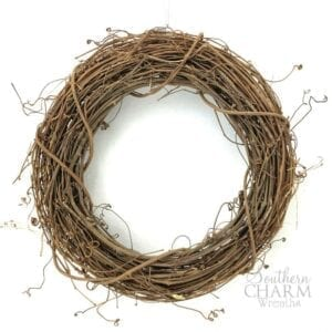 brown grapevine wreath on white background