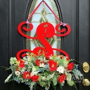 Red monogram door hanger with red white and blue flowers