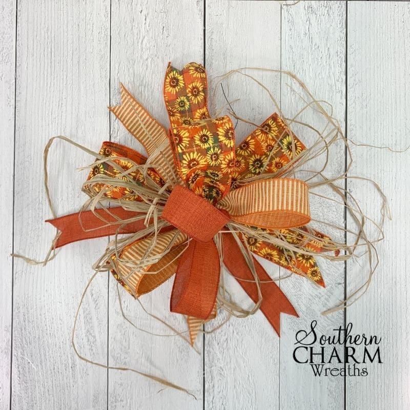 orange fall multi ribbon bow with raffia strands