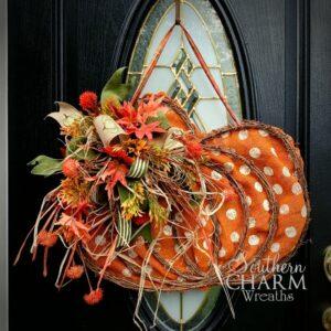 fall pumpkin door hanger on a black door