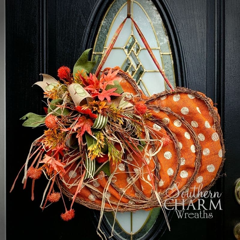 fall pumpkin door hanger on a black door