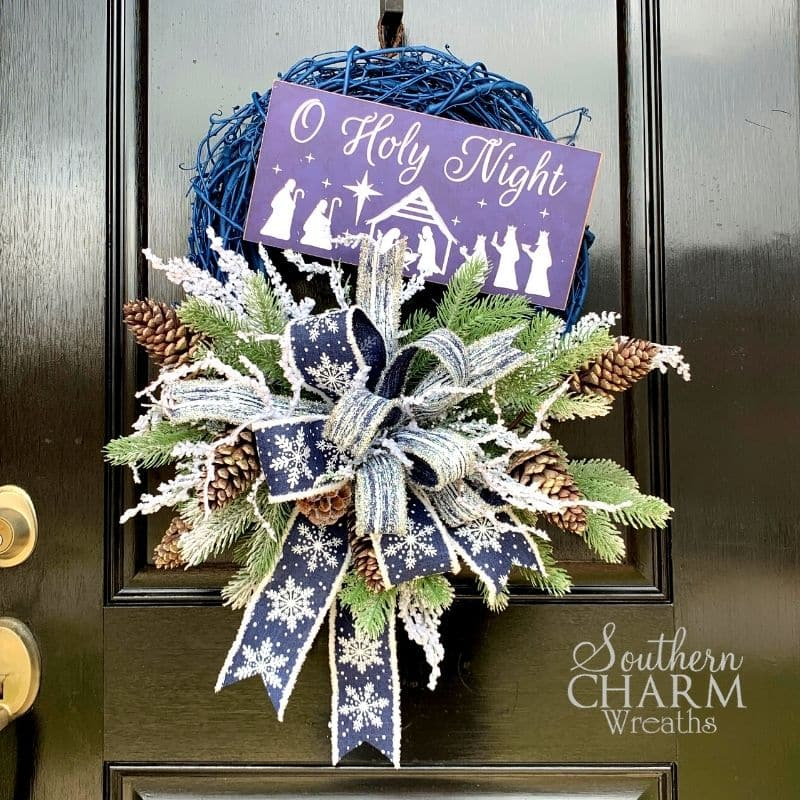 Blue christmas wreath with oh holy night sign
