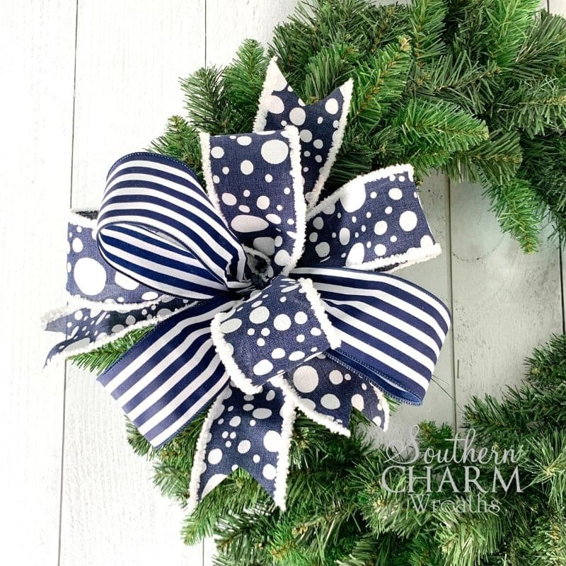 blue bow with two ribbons on a wreath