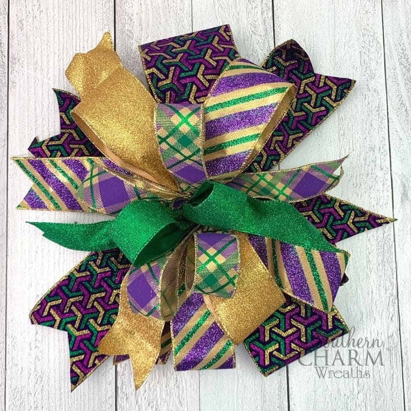 Green, purple, and gold multi ribbon bow with glittery ribbons
