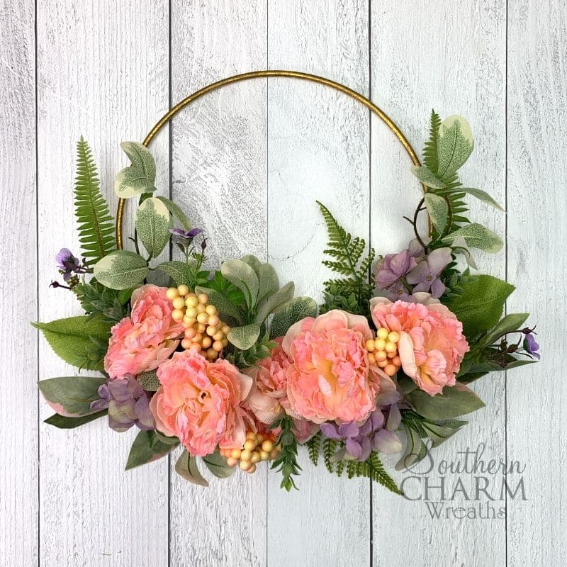 Minimalist spring hoop wreath with peach florals and greenery