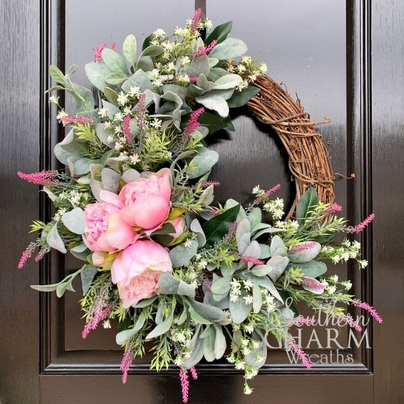 Faux Lambs Ear Wreath with Pink Peony, Lavender and baby's breath on grapevine hanging on a door.