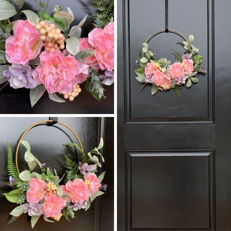 Minimalist spring hoop wreath with peach florals and greenery on black door