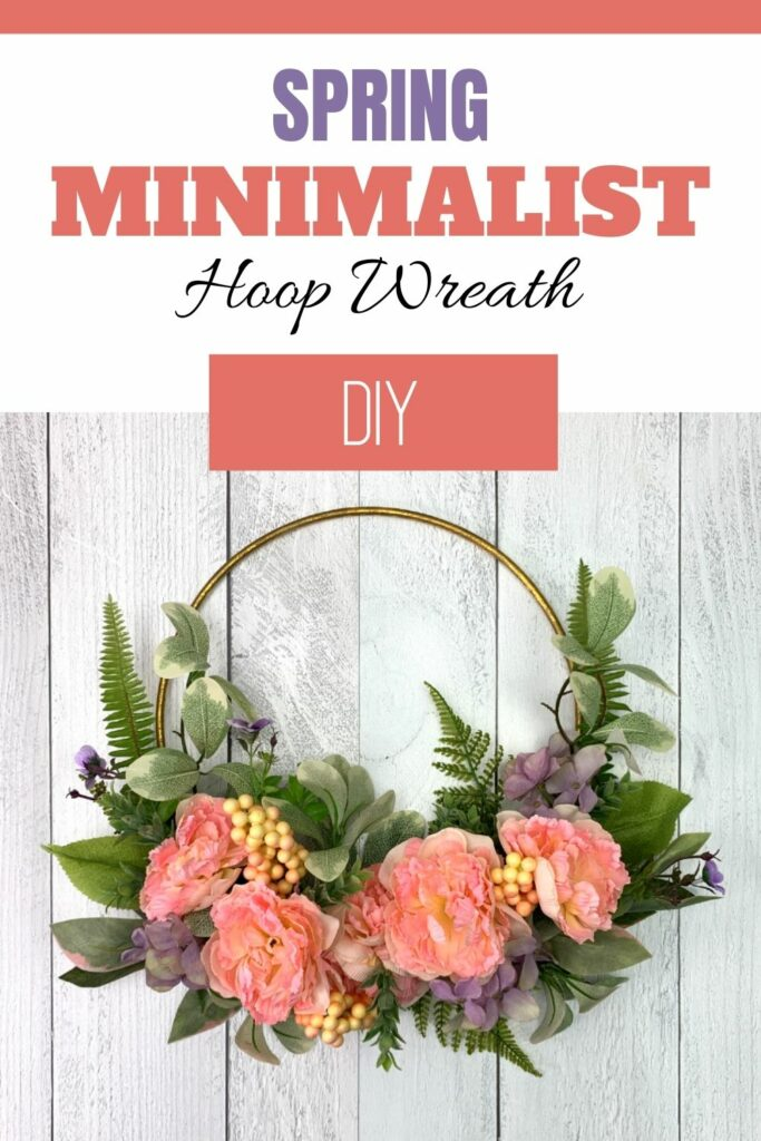 Spring hoop wreath hanging on a white board background