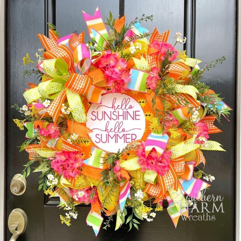 deco mesh summer wreath in orange and yellow on black door