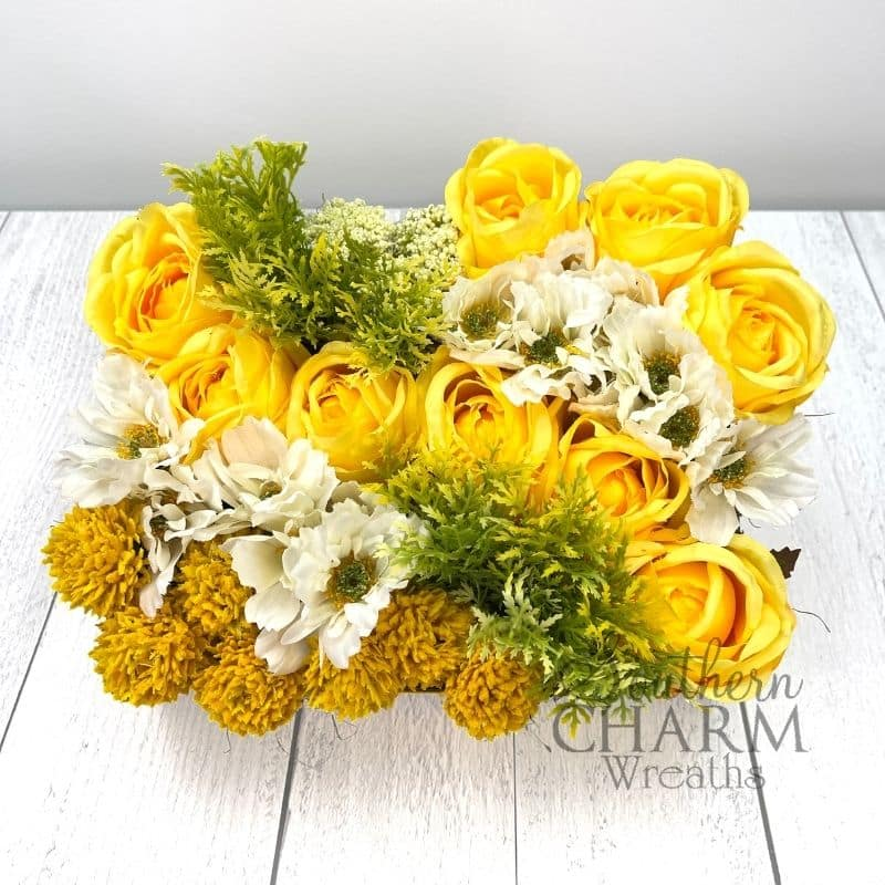 summer flower arrangement with yellow flowers in a pavé style