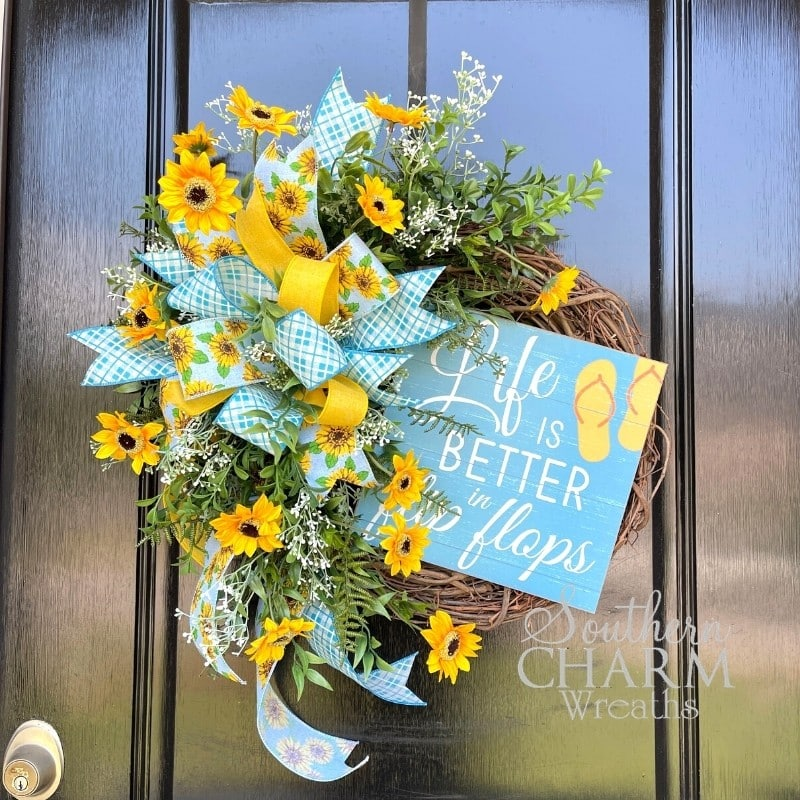 DIY Flip Flop Wreath With Yellow Flowers And blue ribbon