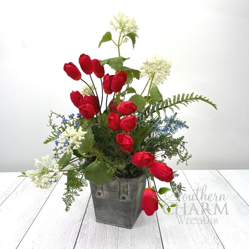 A Patriotic Table Arrangement With Flowers