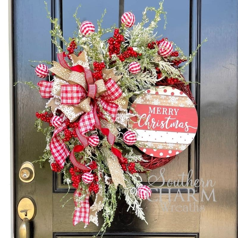 A farmhouse Christmas wreath with a sign that says Merry Christmas